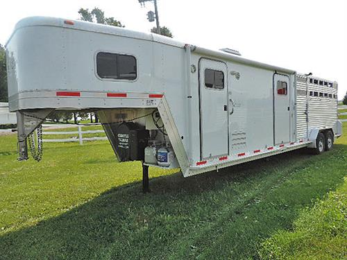 AD#50774A  2010 Exiss Event Custom Stock 14' LQ GN 7'X28'X7', Side Tack & 14' Stock Area, Solid Knotty Alder, Dinette, Soft Touch Walls & Ceiling, 6 cu Refg, Microwv, 2 Burner Stove, Sink, TV, Shower-Tub w/Glass Door, Ducted Furnace, Awning, Hydrau. Jack, 4' Side Tack w/3 Tier Swing Out Saddle Rack, Bridle Hooks, Escape Door Stock Area, Center Gate At 4' Stud Compt, Full Open w/Half Slider Rear Door, Rubber Floor Mats.  One Owner-Very Little Use-Super Clean.  Sale Price  $28,500.00