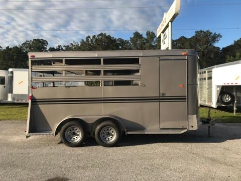 2018 Bee (3) horse slant load bumper pull trailer with a 4' dressing room that has a (3) tier removable saddle rack, bridle hooks and a spare tire! The horse area has an interior height of 7' tall x 6' wide x 16' long, escape door, stock type sides, rubber mats over wood floor and a full swinging rear door and a rear ramp! LIFETIME WARRANTY on the trailer floor!!!!  Beige in color!