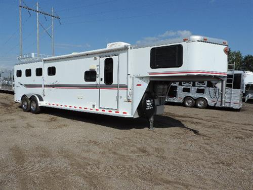 Ad # A0883, 2002, Sundowner, 4 Horse, GN, 9' short wall, LQ, ramp, sofa/sleeper, .06 refrigerator, double sinks, 2 burner stovetop, bathroom, shower, stool, walkthrough to horse area, stud divider with escape at 1st horse, hay rack with ladder.  ~PRICE~$21,900.00~