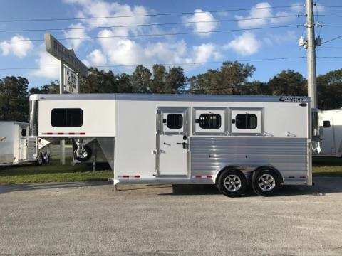 """2018 Cimarron (3) horse slant load trailer with the """"Ready to Go Package"""" that has a hat shelf, boot box, (3) tier swing out saddle rack, 25 gallon water tank, bridle hooks and a door caddy!  The horse area has an interior height of 7'6"""" tall x 7' wide, escape door, stud divider,  drop down windows at the horses heads with drop down aluminum bars, sliding bus windows at the horses hips with the center window being a drop down window, insulated roof,"""
