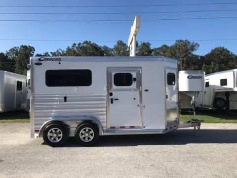 "2019 Cimarron (2) horse straight load bumper pull trailer with a front tack room that has saddle racks, bridle hooks, spare tire and a brush box. The horse area has an interior height of 7'6"" tall x 7' wide, two oversized escape doors with drop down windows and drop down aluminum bars, INSULATED ROOF, roof vents, removable divider with a head shield, rubber lined and insulated walls, rubber mats over all aluminum floor and a rear ramp with dutch doors!"