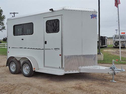 "Ad#15021  2018 Frontier Strider Series 2H Slant BP 6'8""X11'X7' All Alumn White w/ Black Graphics, V-Nose w/Stone Guard, Load Light On Rear & Tack Rm Door, Front Tack Rm Has 2 Tier Removable Saddle Rack, Bridle Hooks, Blanket Bar, Brush Tray, Spare Tire w/Mount, LED Light w/Wall Switch, Floor Level Spare Tire Mount in Tack Room, Spare 15"" Silver Mod Wheel w/ 225/75R15 Tire ( 5-Lug)  MSRP $15,100.00   Sale Price $11,300.00"