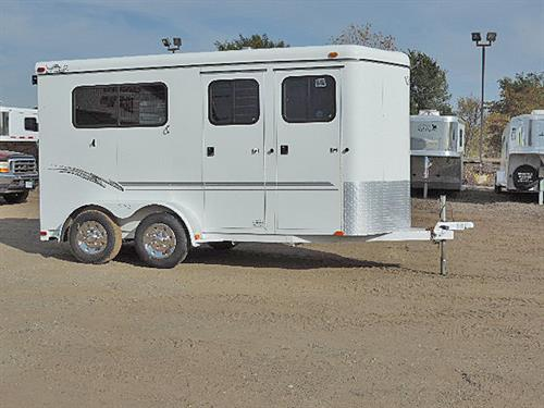 Ad#18032  2001 Trail-et  2H  BP  6'x14'x7'  Straight Load  Divider, Chest Bars, Butt Bars, Escape Door at each horse,  Ramp w/ Dutch Doors above, Carpeted Front Dress or Tack Room, 2-Saddle Rack, Halter Hooks.   Like-new Tires.  Brakes / Bearings all check OK.  Very clean & Ready-to-roll!  Sale Price $6,995.00