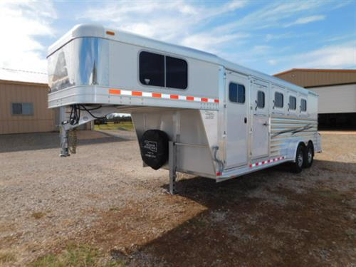 "AD#16262 2016 Elite Mustang GN 7' X 21' X 7', 4 Horse W/3'6"" To 7'6"" Dress Room, Movable 4 Tier Saddle Rack - Dress Room to Rear Tack, Blanket Bar, Bridle Hooks, Brush Tray, Cloth Rod, Carpeted GN-Drop-Floor, 4 Drop Down Windows W/Fold Down Bars, 4 Drop Down Windows On Rump, Padded Dividers, Collapsible Rear Tack, Bridle Hooks, Rubber Lined Walls, Rubber Floor Mats, 4 Roof Vents, 2-5,200 Lb Axles, 235/85 R16 Hankook, Financing & Delivery Available! Sug Selling $35,909 Sale Price $24,500   DEMO"