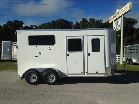 "2018 Kiefer (2) horse straight load bumper pull trailer with a tack room that has a (2) tier removable saddle rack, bridle hooks, brush box and a camper door. The horse area has an interior height of 7'6"" tall x 7' wide x 16' long, (2) escape doors, insulated roof, (2) roof vents, removable divider, head shield, rubber lined & insulated walls and a rear ramp with dutch doors!"