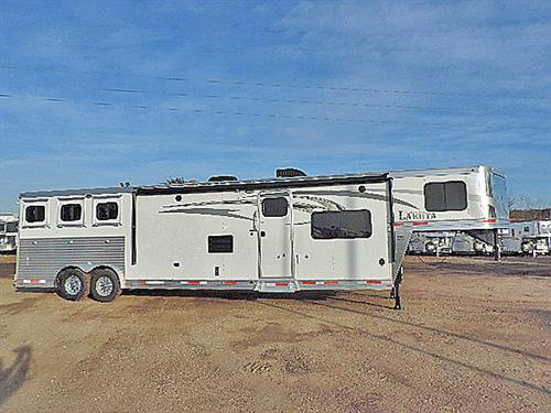 "Ad#0720A  2016 Lakota Charger  3H GN  8'x29'x7'6""  15ft shrt Wall,  6' Slide out w/Dine, Sofa across, Rear Kit., 6cu ft Ref., Oak interior,  Storage, AC/Furn, Neo-Angle Shwr, Van., Porcel. Stl, Pwr Vent, Pwr Awn, Hyd. Jck, Dual Batt., Walk-thru Dr, Stud Divide 1st hrse, Esc Dr, w/Step, Grilled Divides, Mnger at 2 hrse, Drop Dns w/ Grilled Grd, Drops on Butt Side, Fold Rear Tack, 3 saddle/bridle hooks, Brsh Tray, Hrse area Lined & Insul, 40% - 60% Rear Drs, unloading lites. Sale Price: $49,900.00"