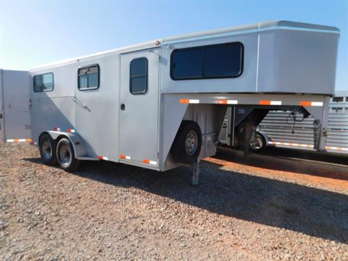 AD#6786 2007 Titan Avalanche GN 7' X 16' X 7' 2 Horse Straight Load W/5' Dress Room, Carpeted GN-Drop, Bridle Hooks, Blanket Bar, Walk-Thru Door, Feed Area, 1 Drop Down Windows W/Bars On Each Side + Sliding Windows, Removable Center Divider, Front & Rump Bars, Rubber Mats. Trailer Is In Good Condition! Trailer Has Been Serviced & Ready To Go! Sale Price $6,400
