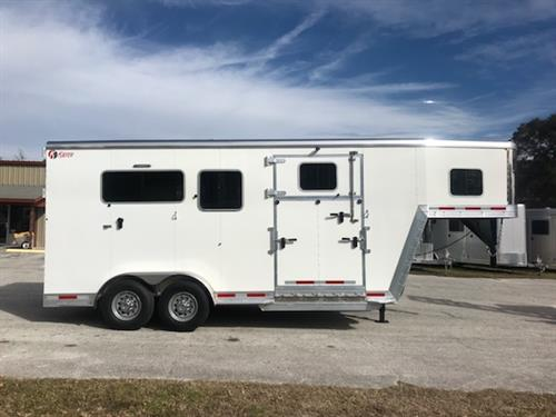 "2018 Kiefer (2) box stall that has an interior height of 7'6"" tall x 7'2"" wide x 16' Long, solid rubber lined drop gate over neck, padded bulk head wall, escape door with drop down windows, side ramp with a dutch door, full swinging rubber lined center gate, rubber mats over all aluminum floor and a rear ramp with dutch doors!  8 year warranty!"