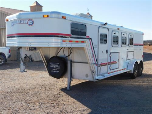 AD#4070 2001 Barrett GN 7' X 20' X 7' 3 Horse, 6' To 10' Dress Room & Side Tack, Carpeted GN-Drop-Floor, Bridle Hooks, 35 Gallon Water Tank, AC-Heat Unit, Swing Out Saddle Rack In Side Tack, 3 Drop Down Windows W/Fold Down Bars, 3 Mangers W/2 Manger Doors, Padded Dividers, Telescopic Divider, Rubber Lined Walls, Rubber Mats, Interior LED Lights, 2 Load Lights, 235/85 R16 10Ply + Spare, 2-7,000 Lb Axles. Trailer Is In Good Condition! Trailer Has Been Serviced & Ready To Go! Sale Price $10,900
