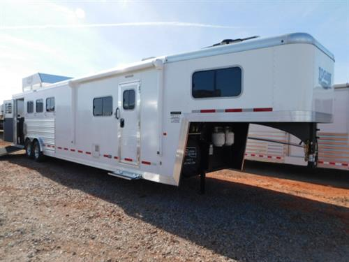 "Ad#6203 2018 Logan Limited GN 8' x 31' x 7'6"" 4 Horse, 12' Solid Knotty Alder Wood 6' Slide-Out, Sofa-Sleeper, 6 Cu Fridge, Large Microwave, 24"" TV, DVD Player, AM/FM/CD Player, 2 Burner Stove, Double Kitchen Sink, Overhead Cabinets, Ducted Furnace, A/C, Porcelain Stool, Neo-Angle Shower W/Glass Door, Walk-Thru Door, Electric Awning, Hydraulic Jacks, Hay Rack W/Aero Dynamic Nose, Side Load W/Ramp & Single Stall Entry Door, Escape Door"
