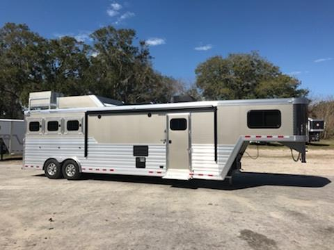 2018 Cimarron (3) horse living quarter with a 13' Trail Boss Conversion that has ducted air conditioning, furnace, corner chair, couch, (2) burner cooktop, sink, convection oven, 6 cu fridge and freezer, stereo system with indoor/outdoor speakers, T.V., cabinets, large closet under T.V, and a huge bathroom! In the bathroom you have a toilet, radius shower, sink with medicine cabinet, and double hanging closet, linen closet and a walk thru door