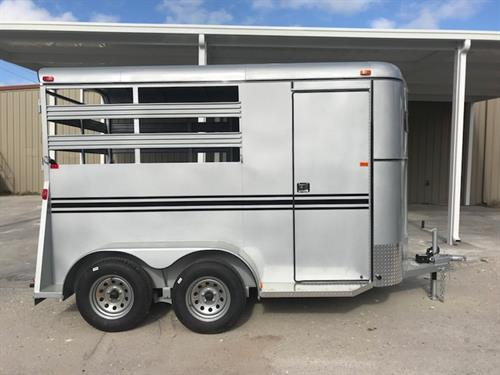 2018 Bee (2) horse slant load bumper pull trailer with a 4' dressing room that has a (2) tier removable saddle rack, bridle hooks and a spare tire! The horse area has an interior height of 7' tall x 6' wide x 14' long, escape door, stock type sides, rubber mats over wood floor and a full swinging rear door! LIFETIME WARRANTY on the trailer floor!!!! Silver in color!