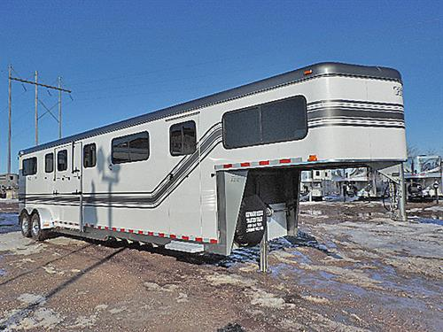 "Ad# 24329  2007 Trail-et Silver Shadow 4H GN 7'x29'x7'6"" Tall, Hd-to-Hd Cntr Load w/4ft Insul. Dress Room, Carpet GN-Drop & Floor, Large GN Windows, 4 Saddle Racks, Bridle Hooks, Escape Door Streetside, Side Ramp w/Door Above,  Full-Width Rear Ramp w/ Doors & Windows Above, 4 Large Body Windows Horse Area, & 4 Head Windows Horse Area, Padded Dividers& Padded Walls, Full-Lined, Insulated & Rubber Side Walls Horse Area, Two-Speed Jack.  EXCELLENT Condition w/Very Little Use.  Sale Price $17,500.00"