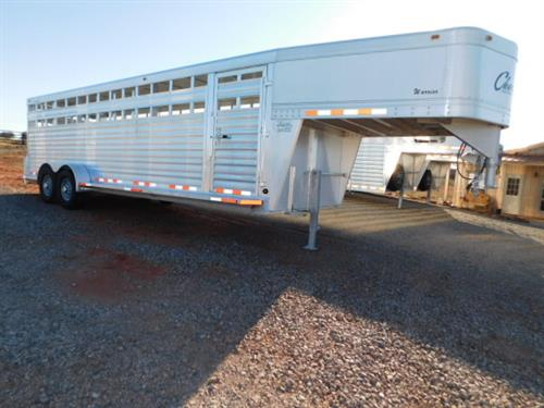 "AD#3772 2013 Cherokee GN 6'8"" X 24' X 6'6"" Warrior Stock, Full Width Rear Gate W/Half Slider, Drop Down Calf Gate, 2 Slam Latch Center Gates, Escape Door, Corrugated Floor, Interior LED Lights, Exterior LED Lights, 2-7,000 Lb Axles, 16"" 10Ply Tires. Trailer Is In Good Condition! Trailer Has Been Fully Serviced & Ready To Go! Sale Price $11,900"