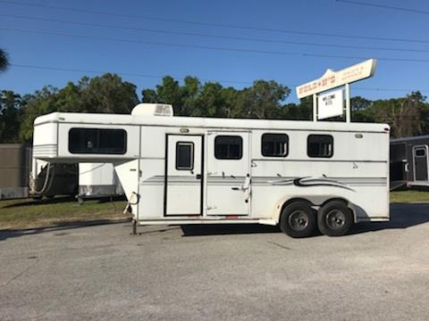 2003 S & H (3) horse slant load weekender package that has a 4' conversion with an A/C unit, sink, cabinets, shower and a bench seat.   The horse area has an interior height of 7' tall x 7' wide, escape door, drop down windows at the horses head and hips, rubber mats over wood floor and double back rear doors!  CONVERSION is 2 YEARS OLD!!!