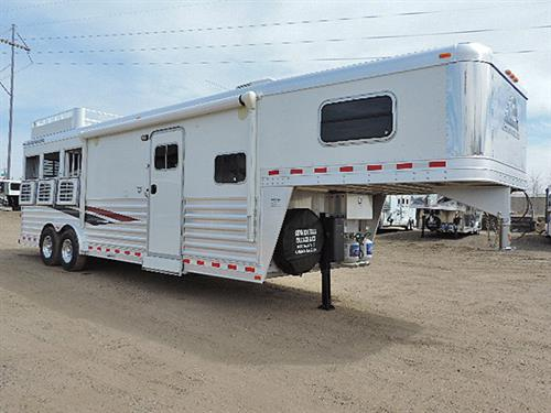 "AD#13079A  2012 Elite Dlx 3 Horse GN 11' LQ 8'X25'X7'6"" All Alumn,  Solid Knotty Alder Cabinets w/Raised Panel Doors, Soft Touch Walls & Ceiling, Dinette-Sleeper, Dble Stainless Steel Sink, Microwv, Recessed 2 Burner Cook Top w/Hood, 6 cu Refg., Ducted AC & Furnace, 24"" TV, AM-FM Radio w/DVD/CD Player, Interior & Exterior Speakers, Lg Hanging Closet w/3 Draws, Pocket Door, Lg Radius Shower w/Glass Doors, Sky Light, Porcelain Stool, Lg Closet w/Shelves, Vanity w/Sink, Hydrau. Jack"