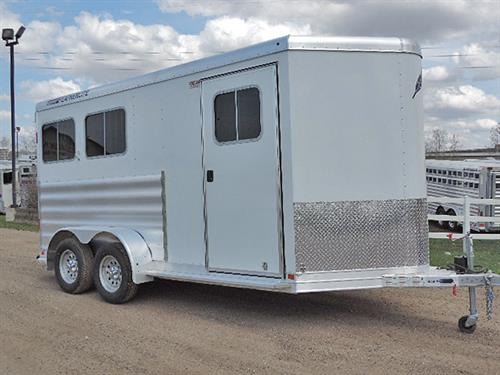 #136946A  2015 Featherlite 2H BP  7'x14'x7'  White, 2ft -6ft Dressing Room, V-Nose, 2 Post Adjustable Saddle Rack – Moveable Front to Rear Tack, 4-Bar Blanket Rack, Bridle Hooks, Brush Tray, Carpet, Camper Door w/Screen, Drop-Down Feed Doors w/Fold-Down Bars, Padded Slam-Latch Divider, Collapsible Rear Tack, Double Rear Doors w/Windows, Double Tail Lights, Spare Tire, Trailer In Like-New Condition!  Sale Price $13,900.00.   Financing and Delivery Available.