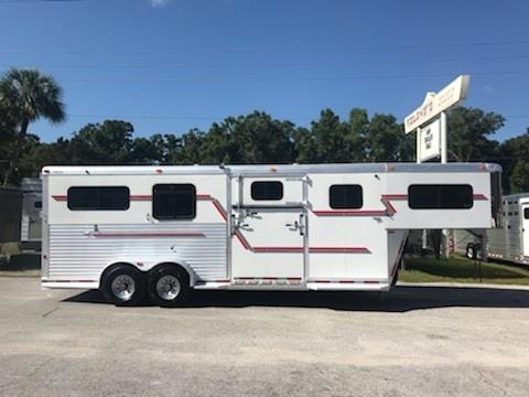 "2006 Adam (2+1) GN Trailer with a tack room that has saddle racks, bridle hook and a walk thru door into the horse area.  In the horse compartment you have an interior height at 7'6"" tall x 7' wide, escape door with a drop down window, roof vents, drop down windows at each horse, removable divider, side ramp with dutch door, rubber mats over all aluminum floor and a rear ramp with dutch doors!  Very clean!"