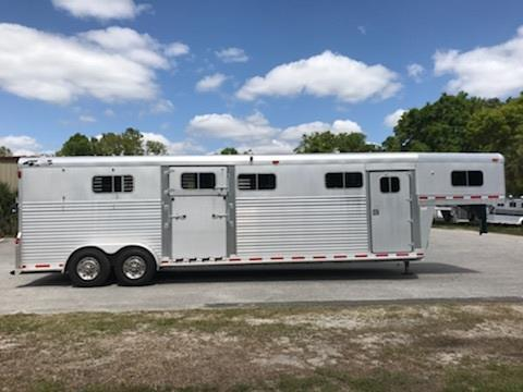 1999 4star Deluxe (4) head to head trailer with a 4' tack room with bridle hooks and storage for your tack. The horse area has an interior height of 8' tall x 7' wide, side ramps with dutch doors on BOTH SIDES of trailer, makes into (3) box stalls or hauls (4) horse head to head, rubber mats over all aluminum floor and a rear ramp with dutch doors! This trailer has two 7000lbs axles and a spare tire. Rated for 14,000lbs. In great shape!