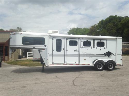 1998 Sundowner (3) horse slant load weekender trailer with a 6' conversion that has an A/C unit, 3cu fridge and freezer, two burner cooktop, cabinets, closets, wired for 110V, walk thru door and a cowboy shower in the first stall. The horse area has an interior height of 7' tall x 7' wide, escape door, drop down windows at the horses heads, sliding bus windows at the horses hips, roof vents, rubber mats over all aluminum floor,