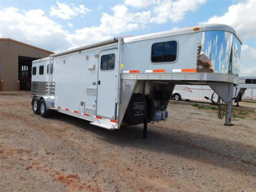 "AD#3575 2011 Exiss GN 6'8"" X 22' X 7', 3 Horse W/8'6"" LQ, Sofa-Sleeper, 3 Cu Fridge, 2 Burner Stove, Microwave, Stainless Steel Kitchen Sink, AM-FM-CD Stereo, AC/Furnace Unit, Camper Screen Door, Interior Speakers, Exterior Speakers, Shower, Wardrobe Closet, Walk-Thru Door, 2 Drop Down Windows W/Fold Down Bars, Escape Door W/Feed Bag, Large Sliding Windows On Rump Side, Collapsible Rear Tack, 4 Tier Saddle Racks, Bridle Hooks, Brush Tray, Stud Divider, Padded Dividers"