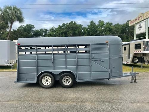 "1990 HMDE 16' Stock Bumper Pull Trailer with a front tack room that has a saddle rack and bridle hooks.  The stock area has an interior height of 6'9"" tall x 6' wide, brand new floor with new rubber mats and a full swinging rear door.  The exterior has brand new tires!  Clean!"