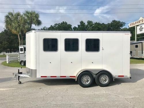"DEMO: 2019 Kiefer (3) horse slant load bumper pull trailer with a large tack room that is fully insulated, carpet floor, bridle hooks, saddle racks, camper door and a spare tire.  The horse area has an interior height of 7'6"" tall x 7'2"" wide x 16' long, drop down windows at the horses heads with drop down aluminum bars, sliding bus windows at the horses hips, insulated roof, roof vents, rubber lined & insulated walls, rubber mats over all aluminum floor,"