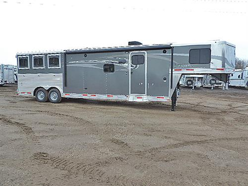 "#00052A  2016 Lakota Charger 3H GN 8'x27'x7'6"" Tall C8315 All Alum. w/13' Oak LQ 6' Slide, Sofa & Dine, Rear Kit, 32"" TV-DVD, CD-AM/FM, Int & Ext Spkrs, 6cu. Ref, Rec Brnr Stv. Mwve, Dbl Snk, Lg Clst w/Drwrs, Neo-Angl Shwr w/Gls Dr, Porc. Stl, Van & Snk, Dual Hyd Jcks, Awn, Sky Lite, Rain Fan, Esc Dr w/HD Feed Dr & HD Fold-Dn Bar, 3 Drp-Dn Wind Rump Wall, Stud Divide, Rear Tack, Step at Esc Dr, Duct A/C to Hrse Area, 4 Ld Lites, Lined & Insul Rf & Sidewlls Hrse Area, Mngers. Price $49,900.00"