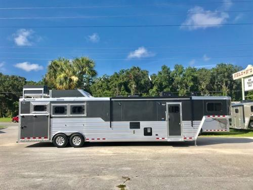 "2018 Cimarron (3) horse living quarter trailer with a 15'8"" Outback Conversion that has air ducted A/C unit, furnace, stairway up to the master bed with reading lights, Shiplap ceiling,  t.v. and tons of storage!  The main cabin has a Slide Out with a couch, corner dinette chair with a removable table, White Washed Hardwood Floors, large double sink, convection oven, 6cu fridge & freezer, spacious cabinets and a large bathroom."