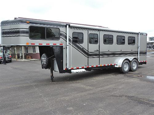 "24210A  2007 Trail-et Conquest  4H GN 7'x22'x6'8"", 4' to 8' Dress Room, Full Lined & Insulated Walls, Carpet GN- Drop & Floor, Carpeted Slant Wall, Walk-thru Door, Lg GN Windows, Esc Door, Drop-Down Feed Doors, w/Fold-Down Bars, Padded Slam-Latch Dividers, Roof Vents, Collapsible Rear Tack w/4 Tier Saddle Rack, Horse Area Lined & Insulated Side Walls, Awning w/Aluminum Cover Guard, 235/85 R16 10 ply Radials, Aluminum Rims,. This Trailer is in Like-New MINT Condition!   Sale Price $12,900.00"