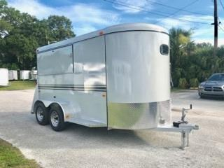 2019 Bee 14' Food Trailer with an interior height at 7' tall x 6' wide x 14' long, drivers side access door, fold down vendor windows that locks, rubber mats over wood floor and a rear ramp with a full dutch door!  The exterior has two 3500lbs axles and a spare tire.