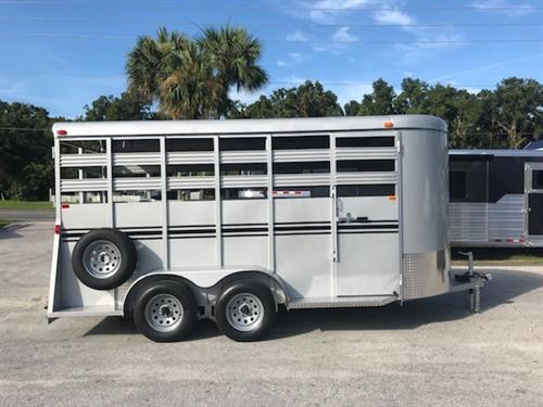 2019 Bee 16' stock bumper pull trailer with an interior height at 7' tall x 6' wide x 16' long, escape door, full swinging center gate, rubber mats over wood floor and a full swinging rear door with a half slider. The exterior has two 3500lbs axles and a spare tire. Silver in color and a LIFETIME WARRANTY on the FLOOR! Silver in Color.