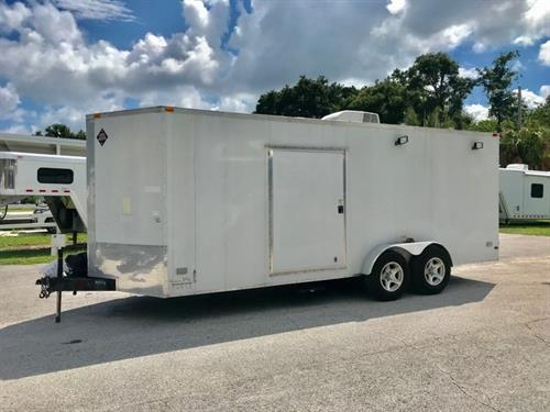 "2014 SGAC 20' Cargo Trailer wired for 30 amp, has an A/C unit, electrical outlets inside, lights, 4 exterior electrical outlets, (2) side doors measuring 66"" tall x 46"" wide, removable front wall if not needed, extra hooks and a rear ramp with a spring assist. The exterior has aluminum wheels, 5200lbs axles with a spare tire, 20' canvas awning and an electric jack. Has only 5000 miles of use. In great condition."