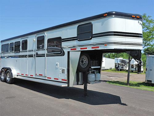 "#83146   2005 Hawk 2H GN  7'x21'x7'6""  Straight load, 8' LQ  Solid Alder, 4 ft Mid Tack, Sofa, 2-Burner Stove, Dbl Sink, Mwave, 3.5 cu Ref., Duct Furn, Walk-thru Dr to Mid Tack, 2 Drs on Mid Tack, Sdl Racks, Brdl Hooks, Brsh Trays, Drop-Dn Feed Doors w/Fold-Dn Bars at Head, Lg Body Windows, Roof Vents, Padded Divider w/Remove Lower Panel, Front Stud Doors, Full-Lined & Insul  Walls Horse Area & Mid Tack, 235/85R26 10-ply Radials w/Alum Rims.  Trailer is in MINT Condition!  Sale Price $15,500.00"