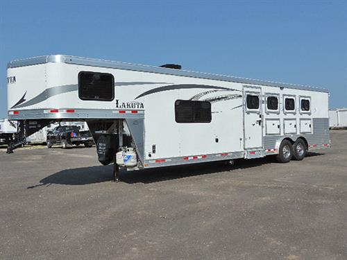 "#00761  2016 Lakota Charger C8411 4H GN 11'LQ,  8'X27'X7'6"", 11 ft Short wall, 6 Cu Ft Refrigerator, Double Sink, 2-Burner Stove, Microwave, AM-FM-CD Player, Awning, Walk-thru Door to Horse Area, Stud Divider, Escape Door w/Step at 1st Horse, 3 Mangers, 40/60 Rear Door, 4 Saddle Racks, Halter Hook.  1 Owner . This is a CLEAN Trailer!  Serviced and Ready-to-Go!  Sale Price ***$39,900.00***"