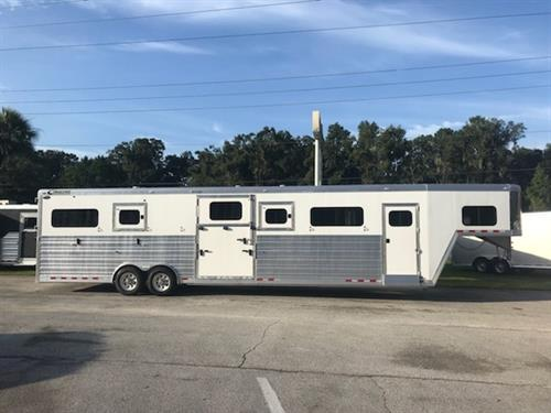 (REORDERED, ARRIVING 2/2019) 2019 Cimarron (6) horse head to head with a 4' tack room that has (4) saddle racks, bridle hooks, blanket bars, sliding bus window in the tack room wall, custom area for your chest/butt bars, brush box, carpet lined tack wall, rubber mat on floor and an insulated roof. The horse area has an interior height of 8' tall x 8' wide, escape door, drop down windows along the sides of each horse, insulated roof,