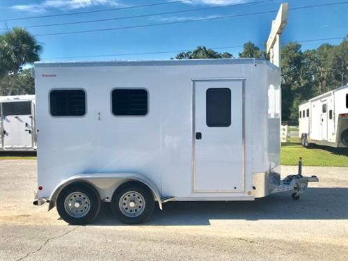 "2019 Kiefer (2) horse slant load bumper pull trailer with a tack room that has a fully insulated roof and walls, saddle racks, bridle hooks and a camper door!  The horse area has an interior height of 7'6"" tall x 7'2"" wide x 14' Long, drop down windows at the horses heads with drop down aluminum bars, sliding bus windows at the horses hips, insulated roof, roof vents, rubber lined & insulated walls, rubber mats over all aluminum floor, rear collapsible tack room"