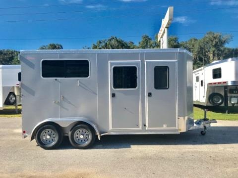 "2019 Kiefer (2) horse straight load bumper pull trailer with a tack room that has a (2) tier removable saddle rack, bridle hooks, brush box and a camper door. The horse area has an interior height of 7'6"" tall x 7' wide x 16' long, (2) escape doors, insulated roof, (2) roof vents, removable divider, head shield, rubber lined & insulated walls and a rear ramp with dutch doors! Champagne in Color!"