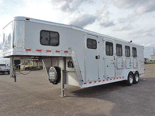 #41694   2002 Kiefer Genesis 4H GN  7.5'x22'x7', All Aluminum, 4' to 8' Finished Dress Room, A/C, Escape Door w/Drop Dwn Feed Door & Fold Down Bars, Collapsible Rear Tack, 4 Tier Saddle Rack, Stud Divider, 40/60 Rear Doors w/Windows, Aluminum Rims, Roof Vents, Trailer Full-Serviced Brakes-Bearings-Lights-Sealed Roof.  Trailer in Good Condition!  Financing and Delivery Available!   ***Sale Price $13,500.00***