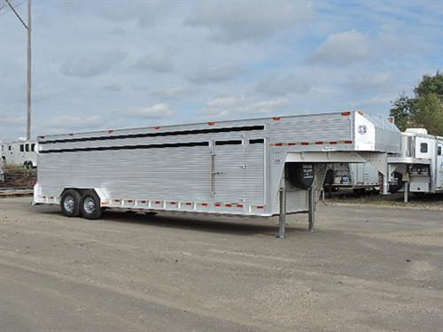 "#4248  2003 Barrett  Stock GN 7'Wide x 28' x 6'6"" Tall.  Two Center Gates with Walk-thru's = 3 equal compartments.  New Brakes and Bearings.  New 16"" 14-ply Tires.   Trailer is in excellent condition!  ***Sale Price $14,500.00***"