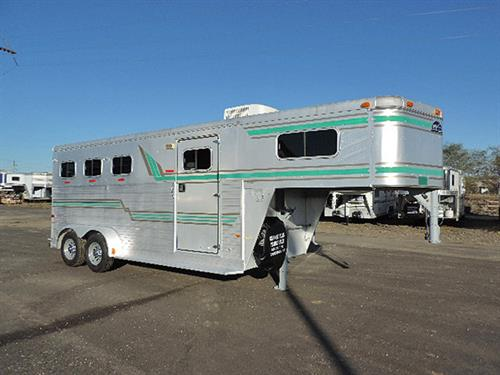 #0595 1994 Sundowner Sunlite 3H GN Dress Rm 7'X18'X7' Tall, Dressing Rm Lined and Insulated, AC, Microwv, 110 Volt also 12 Volt Battery, Walk-Thru Door To Horse Area,  Stud Divider at 1st Horse w/Escape Door, 2 Drop Dwn Windows Head Side, 3 Tier Swing Out Saddle Rack, Folding Rear Tack.  Very Clean Trailer.  New Brakes, Bearings and Tires.  Financing & Delivery Available. ***Sale Price $9,900.00***