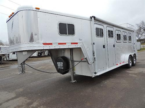#9217  1998 Featherlite  3H  GN  7'x22'x7'Tall, 4 Ft Dressing Room, Camper Door w/Screen, 3ft to 7ft Mid-Tack w/Bridle Hooks, Blanket Bar, Swing-Out Saddle Rack, Awning, Drop-Down Feed Doors, Slam-Latch Dividers, Lined Walls,  Collapsible Rear Tack, 3 Tier Saddle Rack, Double Rear Doors w/ Windows, New 235 R16 10-ply Radials, SS Simulators, Hay Rack,.  SUPER-Clean, Well-Cared-For Trailer!  ***Sale Price $12,900.00***