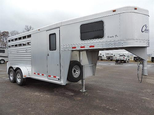 "#2193  2007 Cherokee Brave 3H GN  7'x16'x7"" Tall, 2'-7'6"" Dressing Room, Camper Door w/ Screen, GN Windows, Clothing Rod, Brush Tray, 3 Tier Saddle Rack, Aluminum Bridle Hooks, Padded Dividers, Lined Walls 235 R16 8-Bolt Aluminum Rims, Full-Swing Rear Door.  Trailer has had very little use – in LIKE-NEW Condition!   Financing & Delivery Available.  ***Sale Price $10,500.00***"