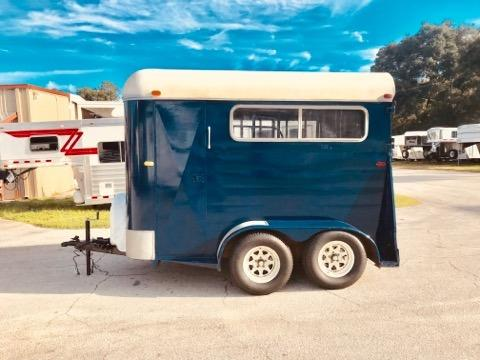 1984 Arnold (2) horse straight load bumper pull trailer with an interior height at 7' tall x 6' wide x 10' long, (2) escape doors, removable divider, rubber mats over wood floor and a rear ramp with dutch doors and a spare tire.