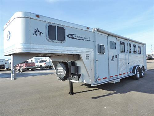 "#58167   2000 Southern Classic  4H GN 7'x23'x6'8"", 6ft Short-Wall Dress Room, Insulated & Paneled Walls, Sofa, Camper Vent, Counter, Closet, Walk-thru Door, Side Tack w/4-Post Saddle Rack, Bridle Hooks, Hydraulic Jack, Drop-Down Feed Doors w/Fold-Down Bars, Padded Dividers, Collapsible Rear Tack.  Full-Serviced In our Shop w/ New Brakes & Bearings, New 235/85 R16 10-ply Goodyear Radials,.  Trailer is in Very Good Condition!  ***Sale Price $12,900.00***"
