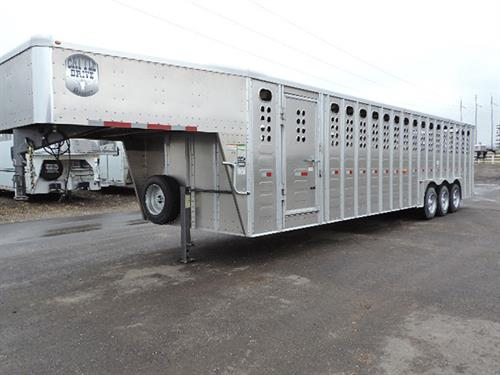 "#27232  2019 Merritt Cattle Drive Stock  GN  8'x32'x6'6"",  8K Dexter EZ-Lube Axels,  215/75/R17.5 16-ply Radials, 2 Slam-Latch Center Gates, .050 One-Piece Alum Roof, Alum Punched Panel,  .077w/Riveted Ext Posts, HD Tear-Drop Alum Fenders, Corrug Rib Floor, I-Beam Heavy Web Fully-Welded Floor, Esc Door, Fold-Down Calf Gate, HD Full-Width Swing Rear Door w/Half-Slider w/LW-90 Hardened Rollers (not affected by Load Chemicals,)  All LED Lights.  Sugg. Price: $38,250.00  ***Sale Price $29,400.00***"