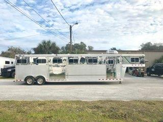 (REDUCED 04/04/19) 2003 4star Deluxe (5) horse head to head trailer with a living quarter that has a 4' Showtime Conversion that has an A/C unit, microwave, 3cu fridge & freezer, cabinets, large closets and a bathroom.