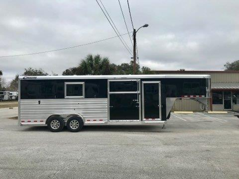 "2019 Cimarron (2+1) GN Trailer with a tack room that has a (3) tier saddle racks, bridle hooks, brush box and insulated roof. The horse area has an interior height of 7'6"" tall x 7' wide x 24' long, makes into two box stalls – 10' box stalls, escape door with a drop down window, side ramp with dutch door, rubber lined & insulated walls, rubber mats over all aluminum floor, double airflow gates, removable divider, rear ramp with dutch doors!"