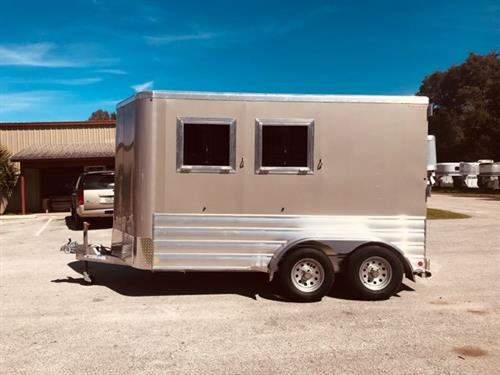"2019 Kiefer (2) horse slant load bumper pull trailer with a front tack room that has saddle racks, bridle hooks and a camper door!  The horse area has an interior height at 7'6"" tall x 7' 2"" wide x 14' long, drop down windows with drop down aluminum bars at the horses heads, sliding bus windows at the horses hips, insulated roof, roof vents, rubber lined & insulated walls, rubber mats over all aluminum floor, rear collapsible tack room with removable center post and double back rear doors."