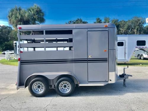 2019 Bee (2) horse slant load bumper pull trailer with a 4' dressing room that has a (2) tier removable saddle rack, bridle hooks and a spare tire! The horse area has an interior height of 7' tall x 6' wide x 14' long, escape door, stock type sides, rubber mats over wood floor and a full swinging rear door! LIFETIME WARRANTY on the trailer floor!!!! Beige in color!